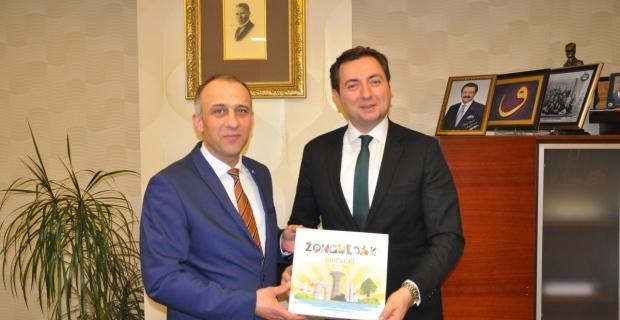 Demir, Başdanışman Cihat Alagöz'ü kutladı