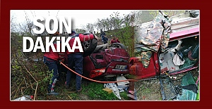 Otomobil şarampole yuvarlandı:  İki kişi araçta sıkıştı